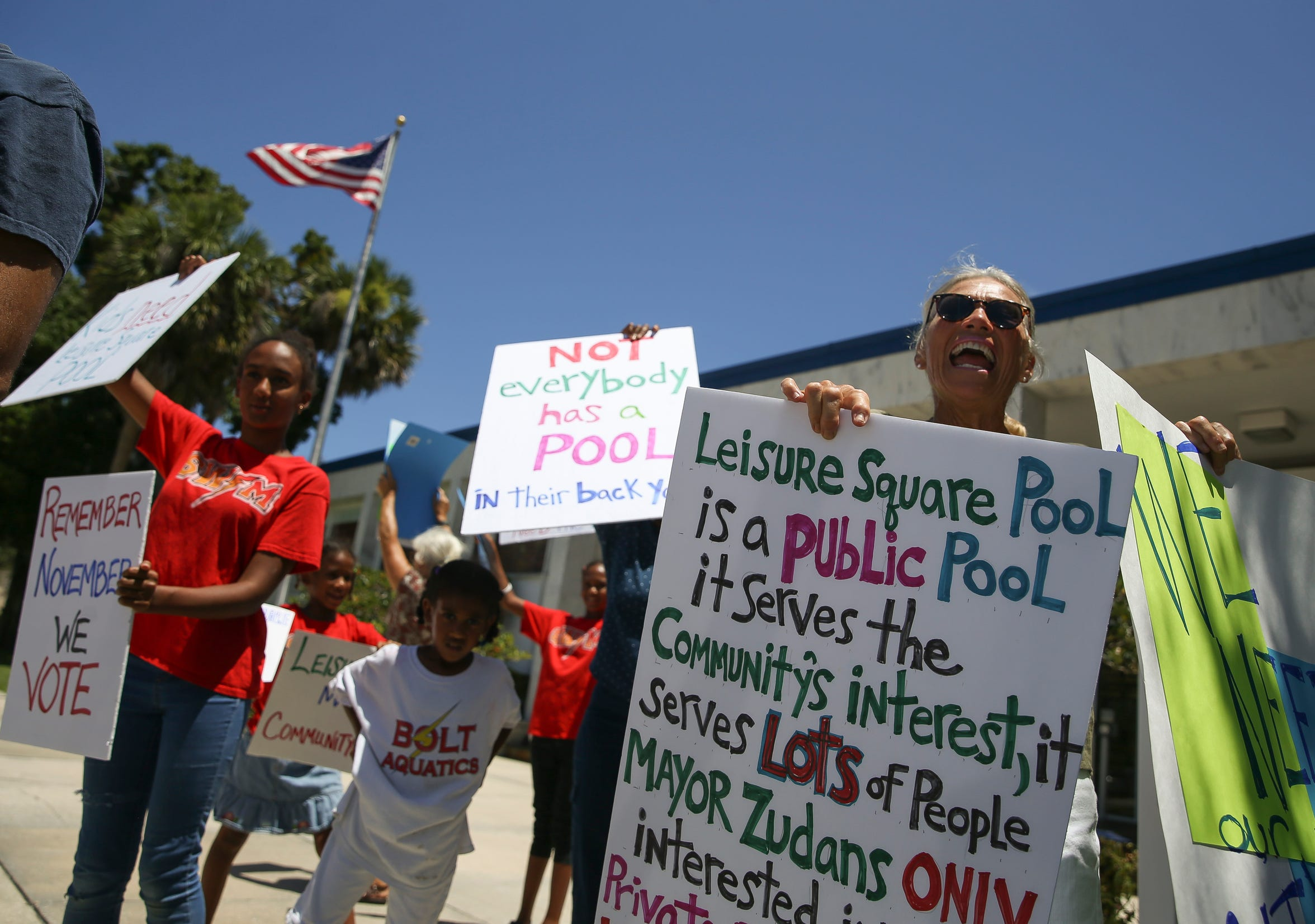 Leisure Square pool supporters protest the closing of the city's only public swimming pool Tuesday, July 16, 2019, before a Vero Beach City Council meeting.