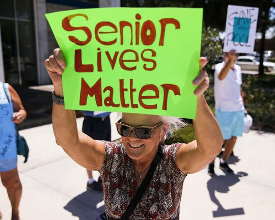 "Carol Paglia, of Vero Beach, protests the closing of Leisure Square pool before a City Council meeting at City Hall on Tuesday, July 16, 2019, in Vero Beach. Paglia moved to the area over a year ago and is grateful for the community she found at the pool. ""Thanks goodness I found Leisure Square pool,"" Paglia said. ""It keeps me healthy and I love the social aspect of it."""