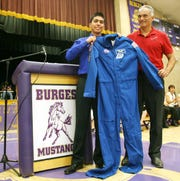 05/02/2012 Former NASA shuttle astronaut Danny Olivas, right, presents Burges High School student body President Daniel Holguin a suit he wore in space Wednesday during an assembly at the school's gym. Olivas is a graduate of Burges.