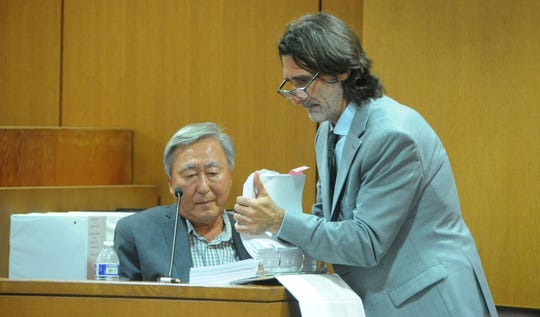 Dr. Soon K. Kim, owner of Signature Healthcare Services, left, is questioned Tuesday in Ventura County Superior Court by David Feldman, a lawyer representing three former patients of Signature's Vista del Mar Hospital. The plaintiffs contend Signature should be held responsible for a former Vista del Mar worker's sexual misconduct.