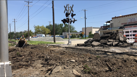 Excavation and removal of railroad track bed was step one on Monday, July 15 for a 'renewal' project at the Wood Street crossing on the Boulevard in Vineland.