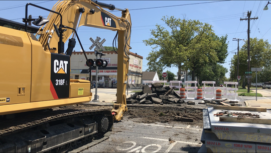 """The busy Wood Street railroad crossing on the Boulevard was closed on Monday, July 15 for three days of scheduled """"renewal,"""" including installing a new type of concrete crossing."""