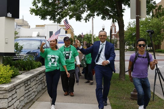 T'xer Zhon Kha/USA TODAY NETWORK-Wisconsin Hundreds of demonstrators, including Marathon County Administrator Brad Karger (in suit), rally May 31 in a peace march inspired by the guilty verdict against 16-year-old Dylan Yang, who was convicted of homicide in March. Marchers walked past the Wausau Police Department, the Wausau School District's administration building and the Marathon County Courthouse.
