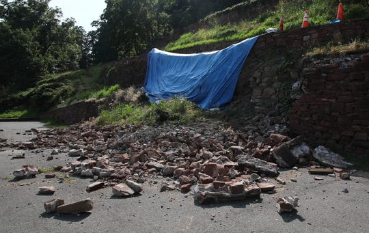 A blue tarp covers a retaining wall that collapsed in the spring closing the road to drivers at Nyack Beach State Park on July 16, 2019.