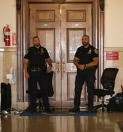 Mount Vernon police officers stand outside of the Mount Vernon mayors office at City Hall, July 16, 2019.