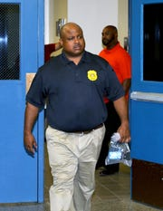 Mount Vernon Police Commissioner Shawn Harris, leaves the police lockup at the Mount Vernon Police Department, after he was held on criminal trespassing charges, July 16, 2019.