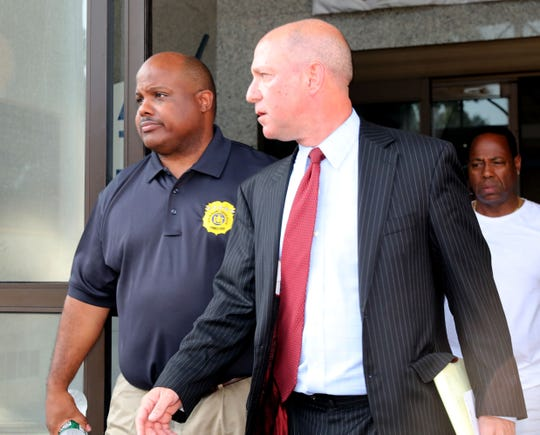 Mount Vernon Police Commissioner Shawn Harris, leaves the police lockup at the Mount Vernon Police Department with his lawyer Jeffery Chartier, after he was held on criminal trespassing charges, July 16, 2019.