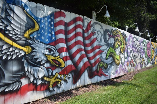 Derrick Noel, also known as Ease, painted this mural for American Art Tattoo.