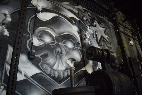 Artist Derrick Noel created this mural at BlkOps Fitness.