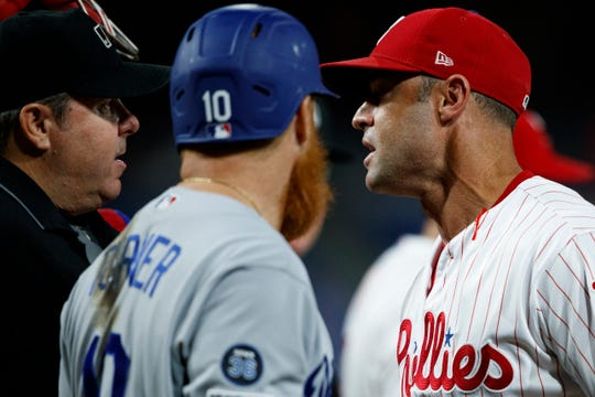 Phillies manager Gabe Kapler argues with the umpire during the eighth inning Monday.