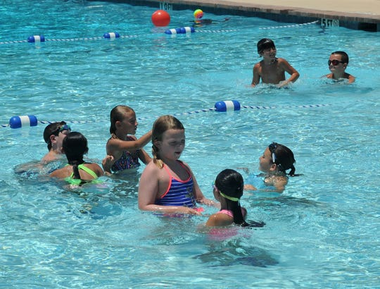 A group of Camp Fire members enjoyed a swim at Harrel Park swimming pool beating the summer heat, after the National Weather Service, in their hazardous weather outlook, said to expect heat index values to range from 100 to 108, Tuesday afternoon.