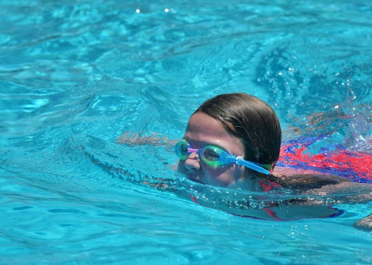 Taking to the pool was one way to stay cool for some kids at Harrel Park Pool, Tuesday afternoon.