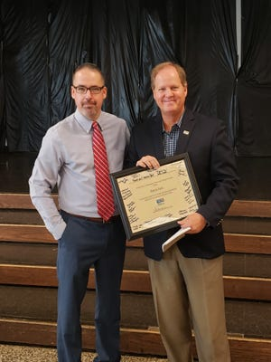 Century Bank CEO Pat Nash, right, stands with local United Way Board President Jason Wilhelm after receiving an award from United Way.