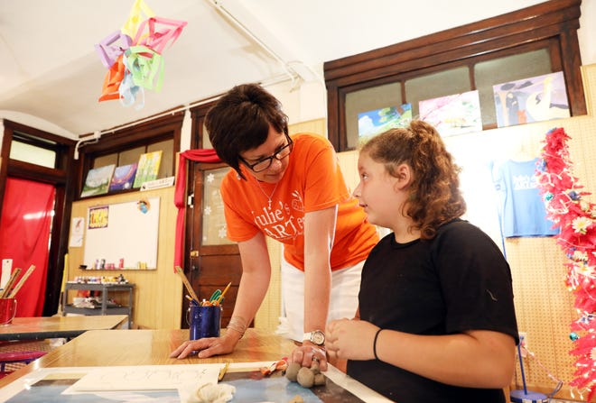 Julie Goodall works with a student in her studio, Julie's ARTery, in the Masonic Temple in downtown Zanesville. Goodall teaches a variety of classes there, when she isn't teaching art at Larry Miller Intermediate School in New Concord.