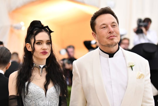 Grimes, left, and Elon Musk at the 2018 Met Gala.