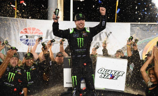 Kurt Busch celebrates after winning the Quaker State 400 presented by Walmart at Kentucky Speedway.