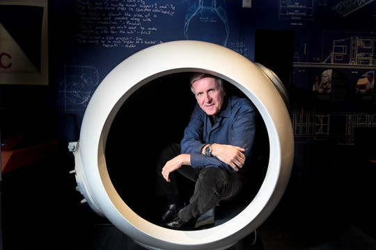 Filmmaker James Cameron in the cockpit of a Deepsea Challenger scale model.