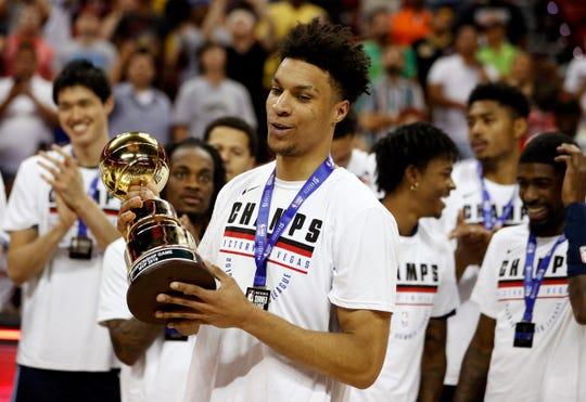 Memphis Grizzlies forward Brandon Clarke holds the Summer League MVP trophy.