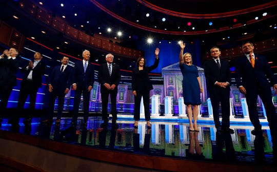 FILE - This June 27, 2019 file photo shows Democratic presidential candidates from left, former Colorado Gov. John Hickenlooper, entrepreneur Andrew Yang, South Bend Mayor Pete Buttigieg, former Vice-President Joe Biden, Vermont Sen. Bernie Sanders, California  Sen. Kamala Harris, New York Sen. Kirsten Gillibrand, Colorado Sen. Michael Bennet and California Rep. Eric Swalwell on the second night of the Democratic primary debate hosted June 27, 2019, by NBC News in Miami.