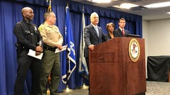 Nicola Hanna, U.S. Attorney for Los Angeles, at the podium announcing the racketeering case against MS-13 members.