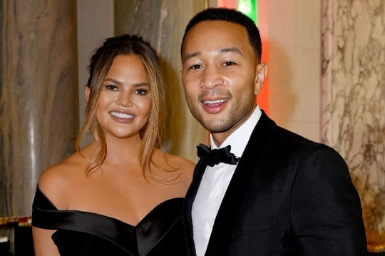 Chrissy Teigen and John Legend in June in Paris.