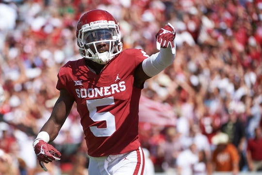 "Oklahoma receiver Marquise Brown did a ""Horns Down"" gesture after scoring a touchdown against Texas last year."