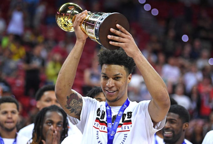 Memphis Grizzlies forward Brandon Clarke raises the NBA Summer League MVP award.