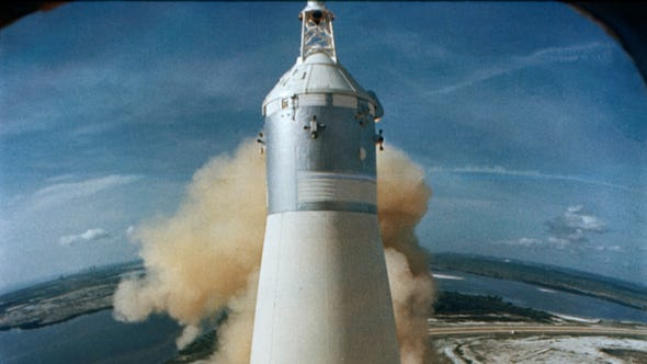The rocket carrying the Apollo 11 crew launches from the Kennedy Space Center.
