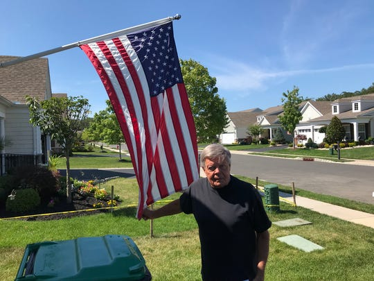 Vietnam vet Mike Burtt wants to install a flagpole in his front yard to show patriotism, but the local homeowners' association won't let him.
