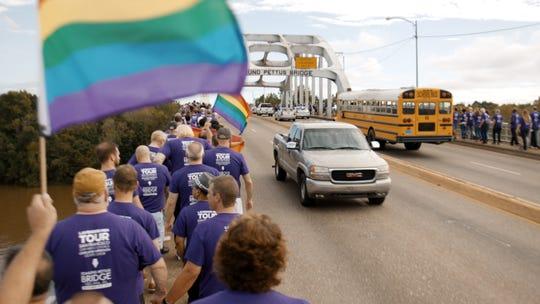 "The San Francisco Gay Men's Chorus and civil rights leaders cross the Edmund Pettus Bridge in Selma, Alabama in a scene from ""Gay Chorus Deep South."""