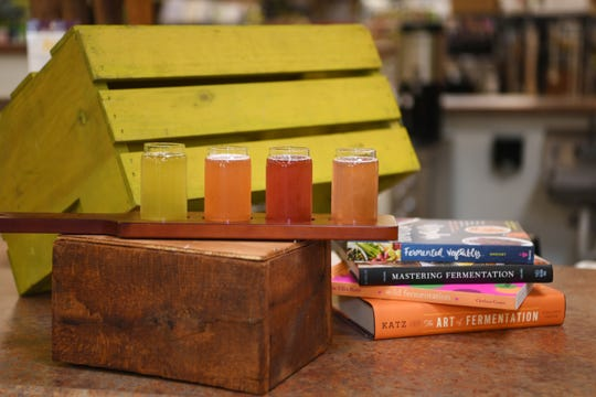 A flight of Jun, a fermented tea made with green tea with honey instead of sugar, from Shanti Elixirs, from the tap at Fifth Season Gardening. The store also has supplies to make your own Jun or kombucha.