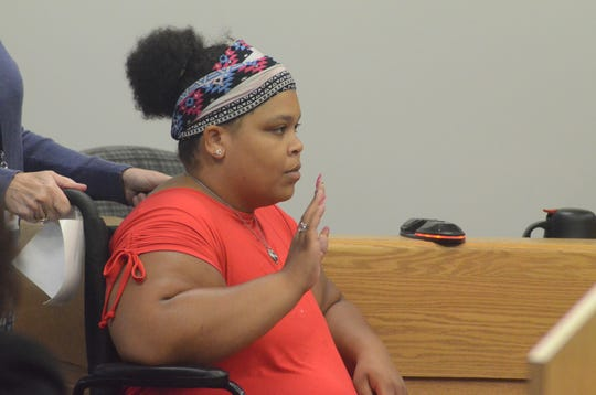 Latesha Bills prepares to testify on Wednesday.
