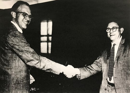 "This undated photo shows Battle Creek native William ""Bill"" Fleming shaking hands with his boss, Abe Silverstein."