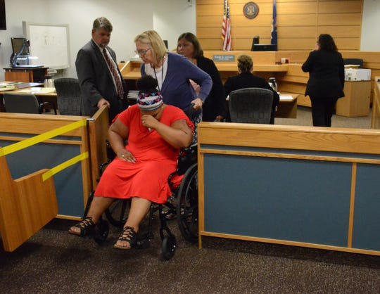 Latesha Bills is taken from the courtroom for a break after a portion of her testimony about a shooting which left her paralyzed.