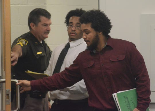Davon West, white shirt, and Jarvis Brown enter the courtroom Wednesday for their trial.