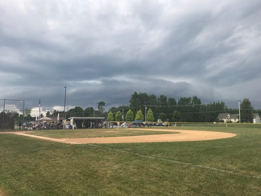 Those ominous clouds hovering above Ted Testa Park in Cortland let loose with rain, wind and lightning and forced the postponement of Tuesday's Section 1 East Little League winners' bracket final between Vestal and Corning. The game has been rescheduled for 6 p.m. Wednesday.