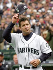In this April 1, 2002, file photo, Seattle Mariners' Edgar Martinez tips his cap to the crowd as he is introduced for the baseball team's season opener against the Chicago White Sox in Seattle. Martinez hit a 2-run single in the eighth. The White Sox won 6-5. Martinez hit .312 with 309 home runs in 2,055 career games with the Mariners. His numbers would be even more impressive if he had broken into the majors earlier. Martinez never played more than 100 games in the majors until he was 27.