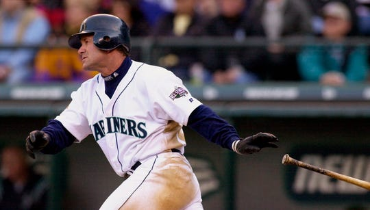 In this April 4, 2001, file photo, Seattle Mariners' Edgar Martinez drops his bat as he heads toward first on his sixth-inning, two-run double against the Oakland Athletics in Seattle. Martinez will go into the Baseball Hall of Fame on Sunday, the first player to spend his entire career with the Mariners--18 seasons in all — and find his way into Cooperstown.