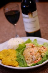 La Estancia de Luisa specializes in Colombian food like this pescado al ajillo, a fish filet with shrimp in scampi sauce