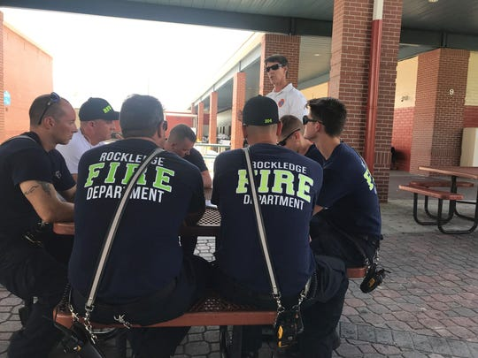 Rockledge firefighters discuss what they learned Monday afternoon after participating in an active shooter scenario at Rockledge High School.
