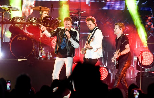 Duran Duran performs for the crowd in the Rocket Garden at Kennedy Space Center Visitor Complex.