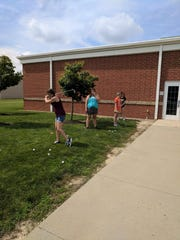 The Galion girls golf team practices short-range shots.