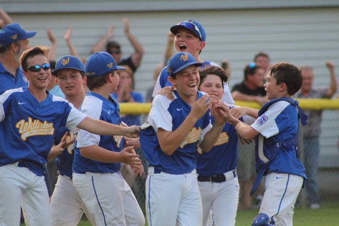 Williston players celebrate their 11-12-year-old District 1 Little League baseball championship victory over Colchester at Schifilliti Park on Tuesday, July 16, 2019.
