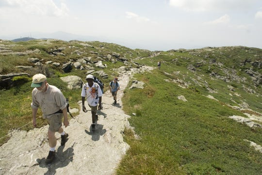 Day hikers head for the Chin, the highest point along the Vermont Long Trail at the summit of Mt. Mansfield at 4,395 feet.