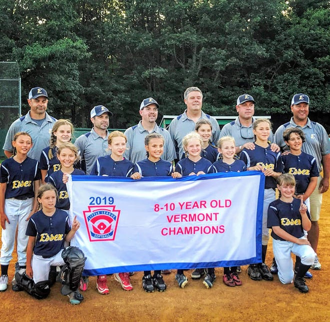 The 8-10-year-old Essex Little League softball team poses with the championship banner after winning the state crown on Tuesday.
