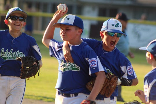 Colchester's Aiden Tatro, left, and Colton Lefebvre, right, celebrate Vinny Wagoner's inning-ending catch against Williston in the District 1 Little League baseball final at Schifilliti Park on Tuesday, July 16, 2019.