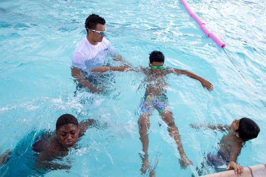 Alex Trujillo, top left, teaches water safety and swim lessons to Cassius Lee, left, 10, and Sebastian Gutierrez, 8, and Rocco Grimaldi, 9, during the annual four-day ZAC Camp on Wednesday, July 17, 2019 at the Boys and Girls Club of the Coastal Bend - Greenwood Unit.