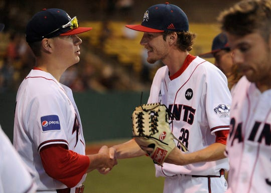 Chillicothe Paints pitcher Zach Kendall shakes hands with teammate and fellow pitcher Taylor Perrett. Kendall did not even play baseball in 2017 or 2018, but now he is one of the best arms in the Prospect League.