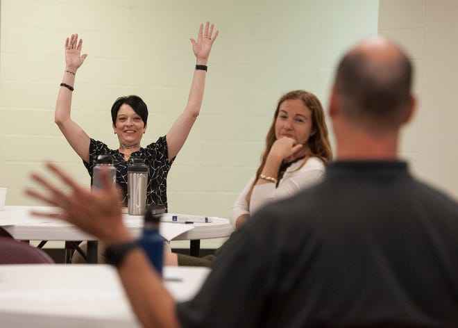 "Brandy Morris-Hafner raises her hands in celebration as she and a group of Chillicothe residents discuss how the M.A.D.E. program has been such a positive influence in the lives of the younger generations and how many have pledged not to take drugs on July 16, 2019, in Chillicothe.  Morris-Hafner, who has been in recovery for 11 years, has a personal essay in a new book containing stories about opioids in Ohio called ""Not Far from Me: Stories of Opioids and Ohio."""