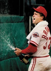 Reds pitcherTom Browning celebrates his perfect game.